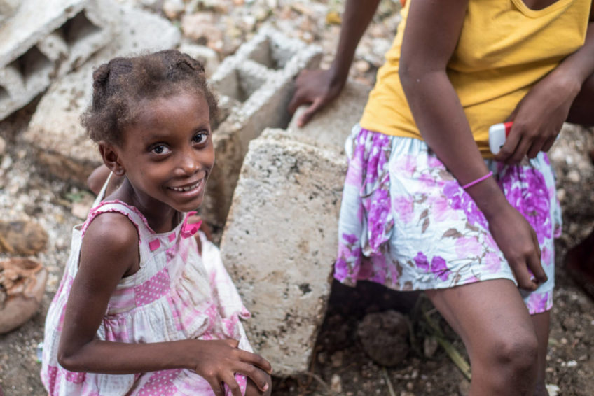 Children play in the rubble of broken houses in Dupuy on the coast of Nippes. On Haiti's southern peninsula, Hurricane Matthew's high winds and rainfall were sometimes matched in destructive force by storm surge. (©2016 Guy Vital-Herne/World Vision)
