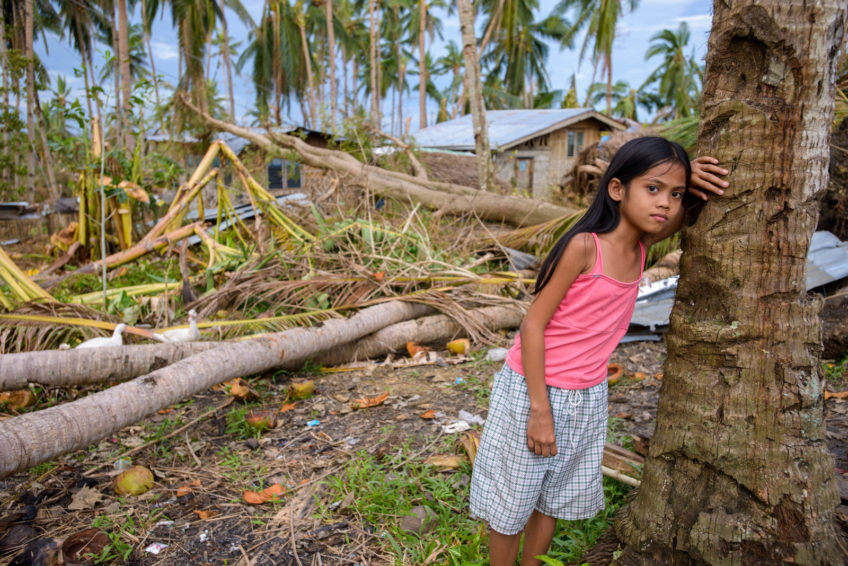 Baby Claire, 9, stands amid coconut trees downed by Typhoon Haiyan, hit the Philippines on November 8, 2013, as a category 5 storm. It laid waste to the country's central region, killing more than 6,000 people and leaving more than 4 million people homeless and hungry.