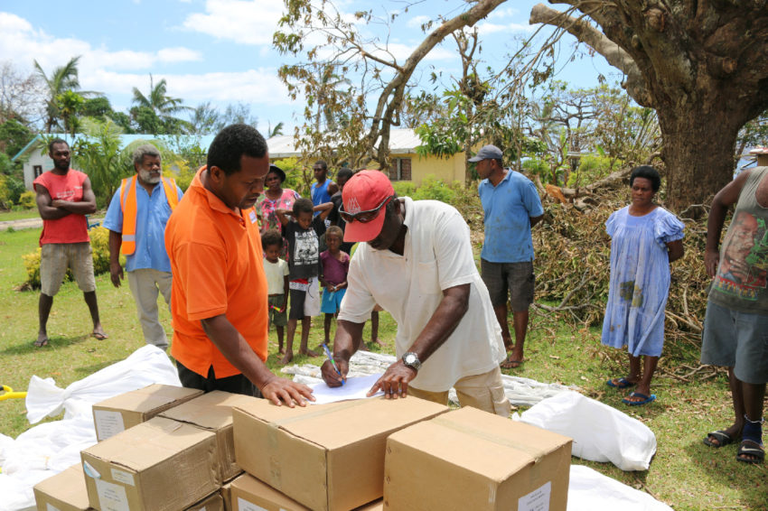 2015 Cyclone Pam_Vanuatu_In the wake of Cyclone Pam, World Vision worked with communities across Shefa, Tafea, and Penama Provinces to distribute essential items such as tarpaulins and shelter kits, kitchen kits, tool kits, as well as helping with government food distributions. (©2015 World Vision/photo by Jodi Devine)