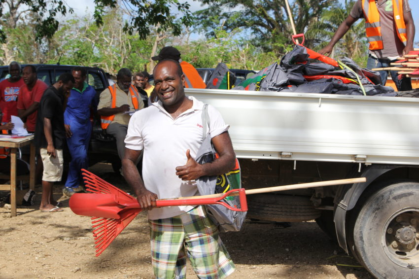 2015 Cyclone Pam_Vanuatu_Families received tool kits in an aid distribution near Port Vila, Vanuatu. Items in the kit include rake, shovel, mallet, wire, and nails. (©2015 World Vision/photo by Andrea Swinburne Jones)