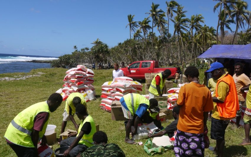 2015 Cyclone Pam_Vanuatu_Staff prepare for a food distribution to Vanuatu islanders who lost homes and crops to Cyclone Pam. (©2015 World Vision/photo by Mike Wolfe)