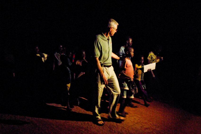 Rich Stearns walks alongside children to a safe house called Noah's Ark Shelter in Uganda.