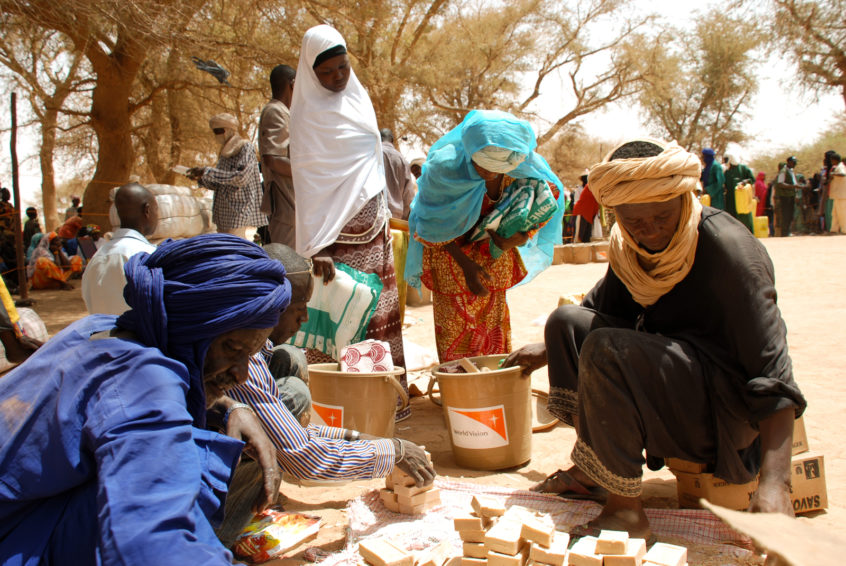 Political unrest, ethnic conflict, and drought are recurring issues in Mali. Refugees fleeing the Mali conflict in 2012 receive aid at a World Vision distribution point in Niger.