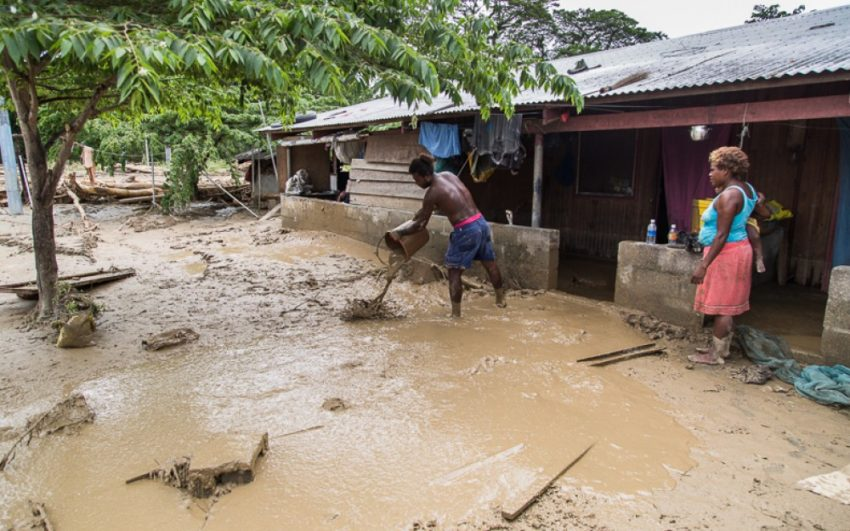 In disaster-prone Solomon Islands, villagers clear mud from their houses in the Guadalcanal Plains after 2014 floods. Heavy rain from a tropical depression, which later became Tropical Cyclone Ita, caused severe flooding at the beginning of April 2014.