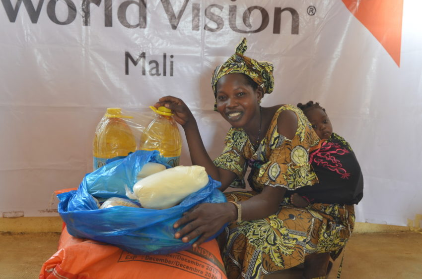 """Mali conflict and drought have created a humanitarian crisis in the West African nation. """"My husband is a rice farmer, but last year the harvest was very bad,"""" says Fatumata Troure, 20. She depends on a World Vision food distribution to have enough to eat and a balanced diet for her family."""