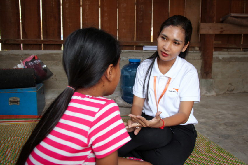 Child rights violations in Cambodia. Chenda (name changed), 13, meets with a World Vision trauma recovery manager. At her home in Cambodia, she was brutally raped, beaten, and strangled by a family friend, who also killed her dog. Counseling has helped her recover. (©2016 World Vision/photo by Ratha Ung)