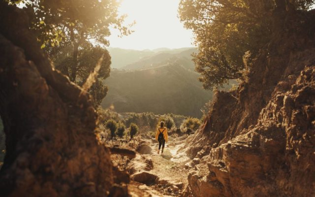 At sunrise, a girl in China hikes a mountain path for two hours to journey to school.