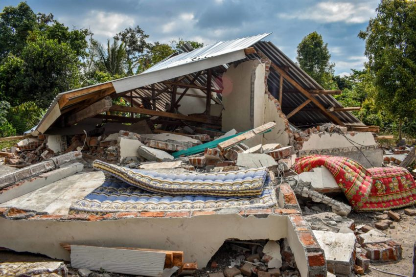 Lombok, Indonesia earthquake damage and scenes of devastation after the Aug. 5 Lombok, Indonesia, earthquake include collapsed buildings and bridges, homes crushed and flattened, and an exodus of tourists stranded along the shoreline.