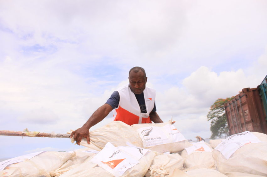 World Vision staff member Osbert Lalahu loads shelter kits on to a truck for shipment to Makira province for children and families affected by the 2016 magnitude-7.8 earthquake in the Solomon Islands.