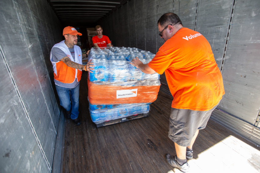 World Vision staff and volunteers offload relief supplies from a truck for distribution in Lumberton, North Carolina.