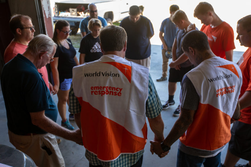 World Vision staff and volunteers gather to pray for the Hurricane Florence relief efforts.