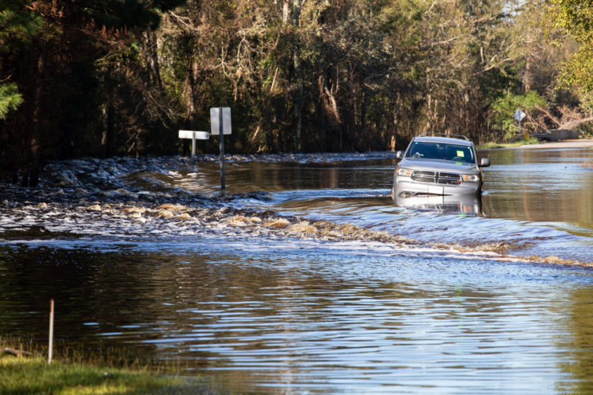 An abandoned car sits partially submerged at the Robeson-Bladen County line, North Carolina, from Hurricane Florence flooding.