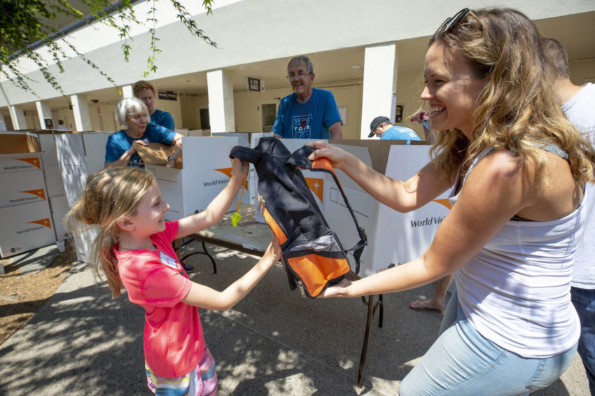 The 1 millionth kit makes its journey in the San Francisco Bay area from 7-year-old Caroline at Menlo Church to 9-year-old Estefani at Familia Cristiana Verbo.