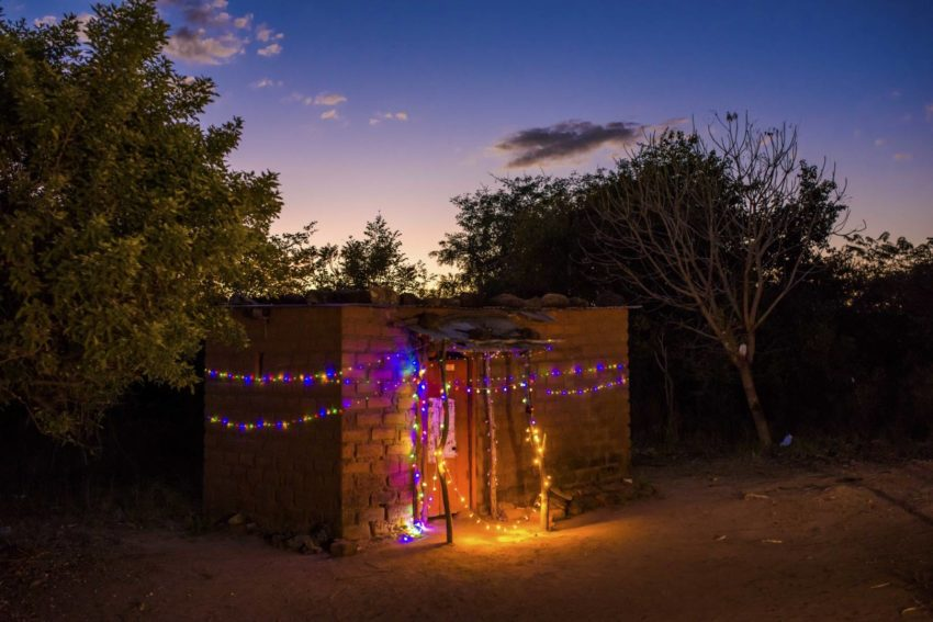 Battery-powered Christmas lights hang on the house of a sponsored child in Zambia.