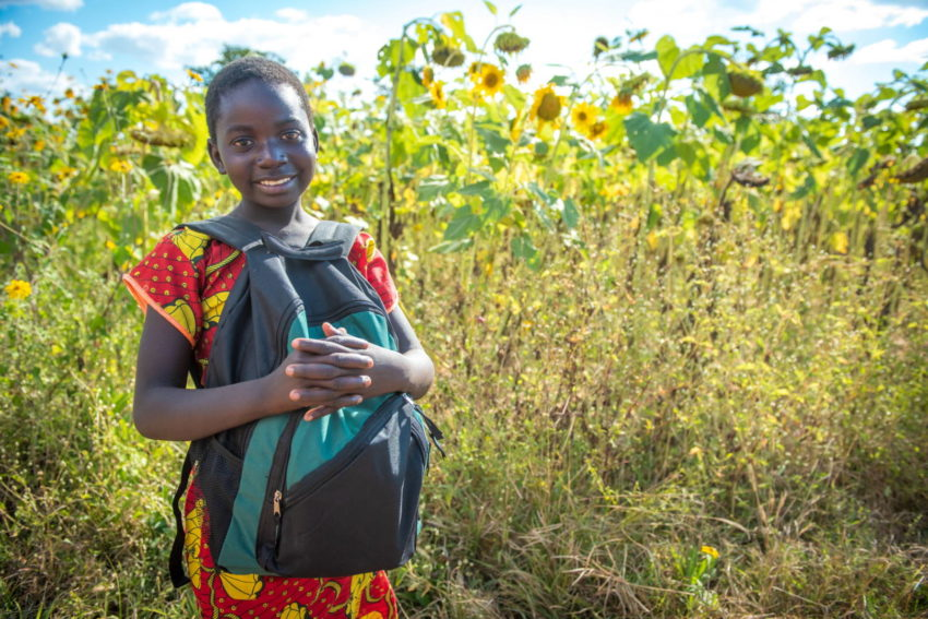 Ivy in Moyo, Zambia, was delighted to receive a World Vision Promise Pack, which contains school supplies, hygiene items, and an insect-repelling blanket.