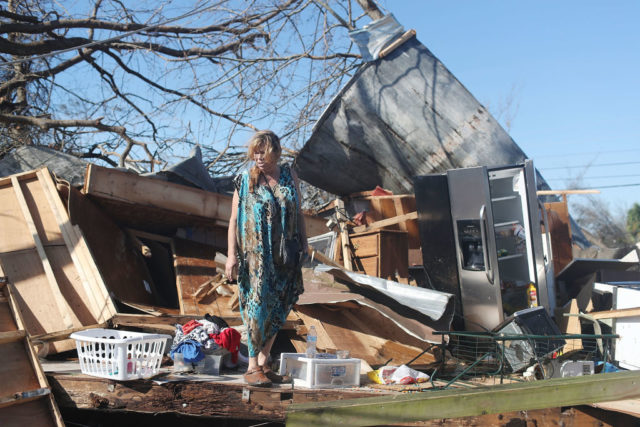 Kathy Coy stands among what is left of her home after Hurricane Michael destroyed it on October 11, 2018 in Panama City, Florida. She said she was in the home when it was blown apart and is thankful to be alive. The hurricane hit the Florida Panhandle as a category 4 storm.