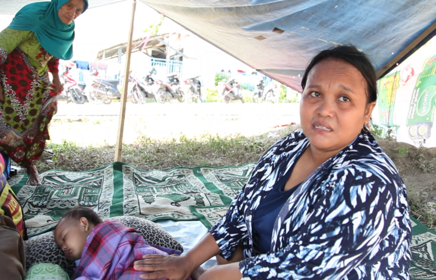 "Indonesia earthquake and tsunami, Sept. 28. Nursanti, 32, and her 8-month-old child, Nabila, have been sleeping under a makeshift cover since the Indonesia earthquake of Sept. 28. ""I am still in shock,"" Nursanti says. ""We have lost everything; our house is flat on the ground."" It is windy and cold at night, she says, and Nabila has caught a cold."