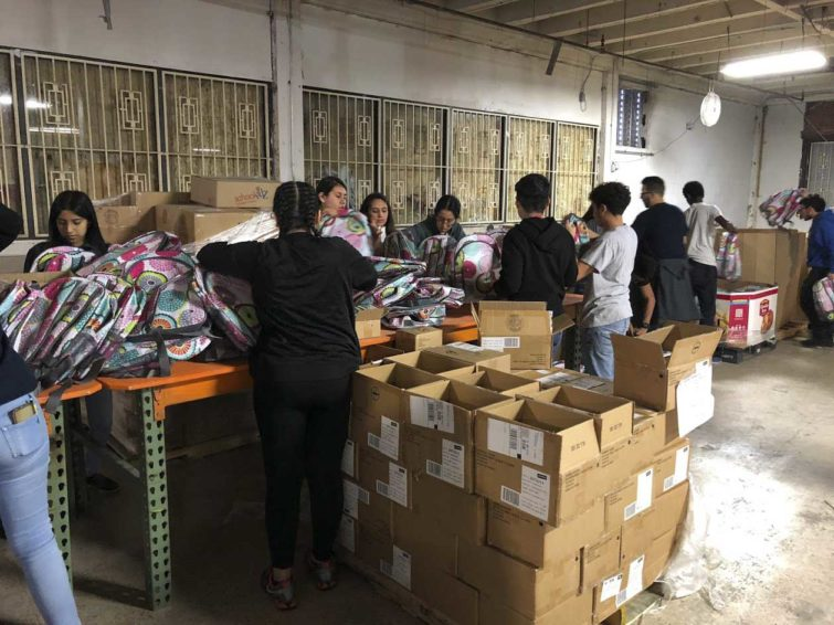Volunteers assemble kits with Thirty-One Gifts products at World Vision's Houston warehouse. The kits were distributed to Hurricane Harvey survivors last year.