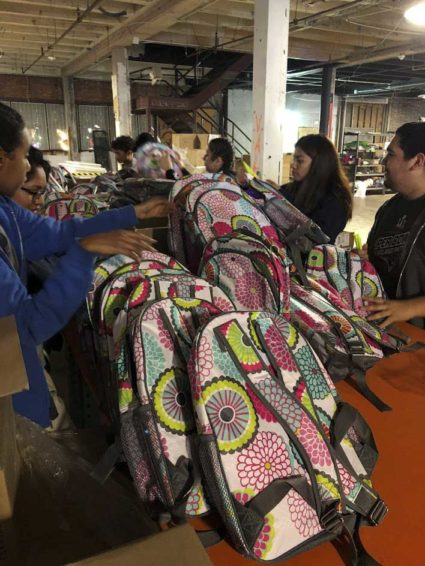 Volunteers assemble kits with Thirty-One Gifts products at World Vision's Houston warehouse. The kits were distributed to Hurricane Harvey survivors last year. (Photo courtesy of Thirty-One Gifts)