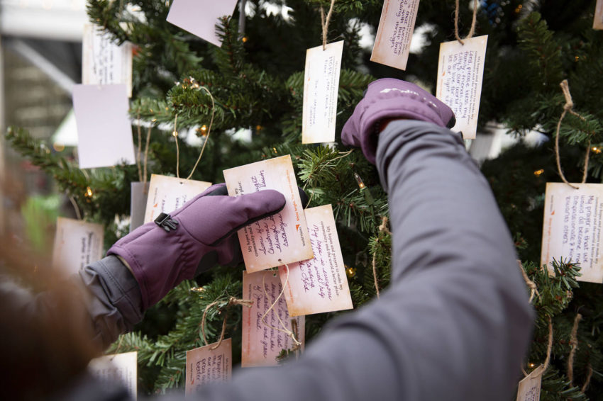 Messages of hope and prayers are hung on the Give-back tree, new to the Give-back Gift Shop this year.