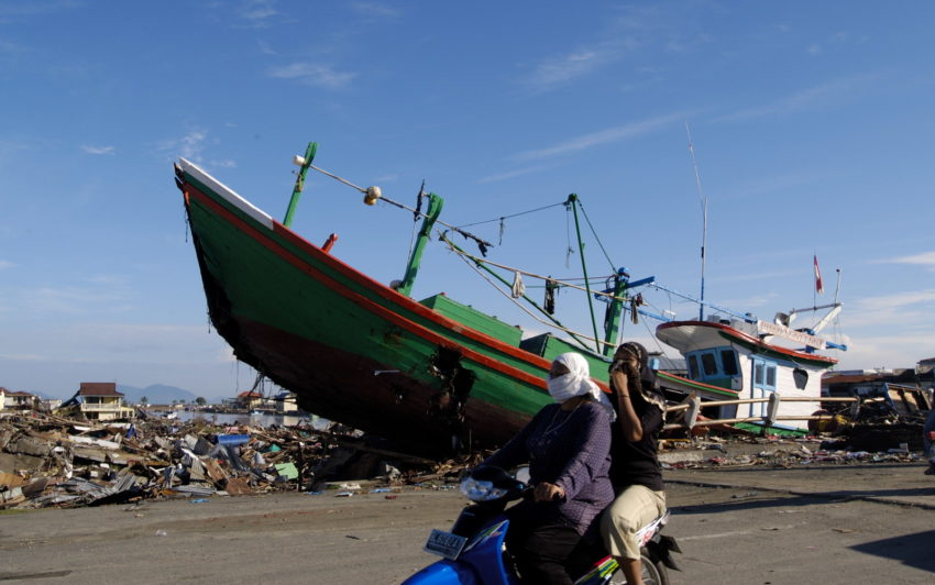 The 2004 Indian Ocean tsunami left a jumble of collapsed buildings and beached boats in Banda Aceh, Sumatra, following a magnitude 9.1 earthquake that struck off the Indonesian coast on Dec. 26, 2004. One of the worst disasters in history, the 2004 Indian Ocean tsunami affected at least 14 countries and left about 250,000 people dead or missing.