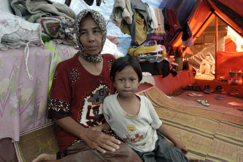 The 2004 Indian Ocean tsunami made 5-year-old Idawati an orphan. Her parents and younger sister were swept away and killed by the massive waves. Now she and her grandmother, Syawariah, 45, share a makeshift shelter with five other families.