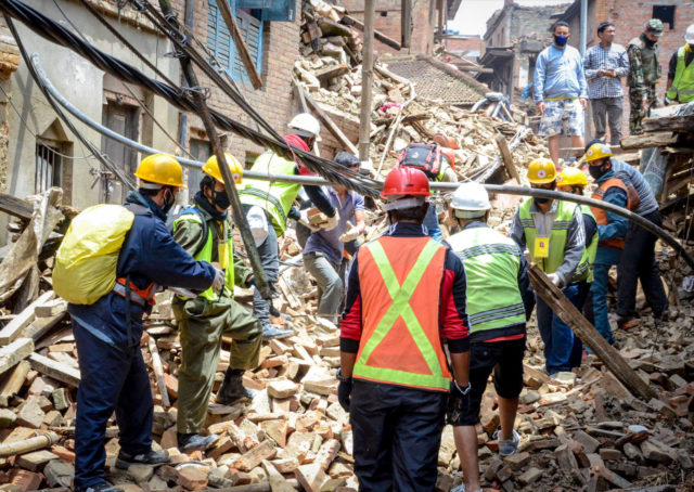 2015 Nepal earthquake in Kathmandu, the capital of Nepal. Search and rescue workers look for victims amid the rubble of collapsed buildings. The quake also caused landslides and avalanches in the Himalaya Mountains.