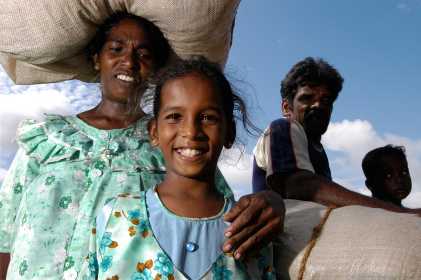 After the 2004 Indian Ocean tsunami, these Sri Lankan parents were separated from their daughter, a World Vision sponsored child. They thought she was dead, but days later, they were reunited at a World Vision aid distribution. About 30,000 people were killed or missing in Sri Lanka after the powerful tsunami struck the coastline.