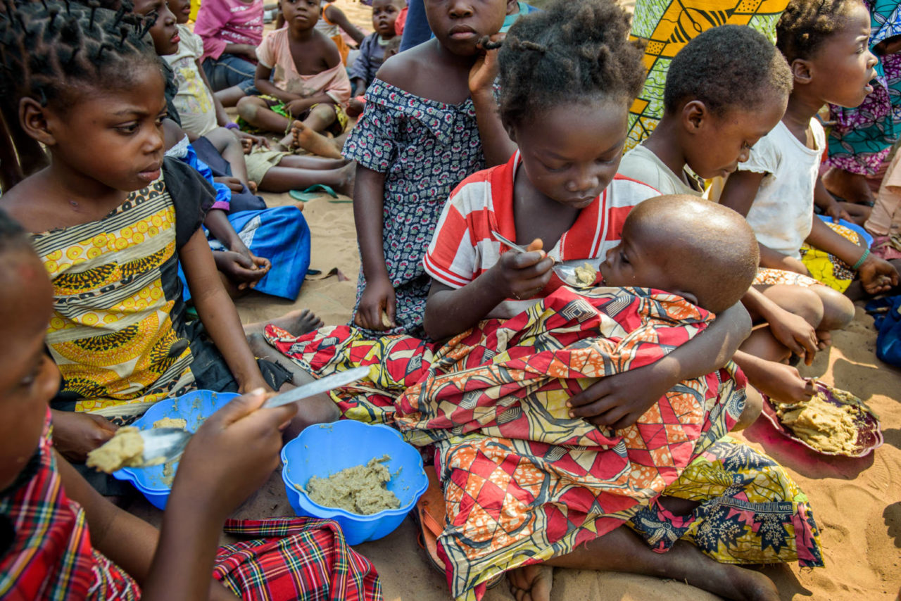 Malnourished children receive fortified porridge at the World Vision Child-Friendly Space in Central Kasai province, Kananga, Democratic Republic of the Congo.