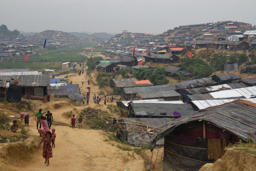 Refugees from Myanmar walk among a landscape of makeshift shelters and tents in a refugee camp in Bangladesh. The refugee crisis in Bangladesh is one of the worst disasters of 2018.