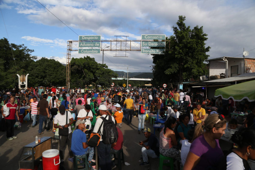 The border crossing at the Simon Bolivar International Bridge from Venezuela into Colombia teems with new arrivals. The Venezuela economic and migration crisis grew throughout 2018. Hyperinflation, political instability, and food and medicine shortages have caused 3 million people to leave Venezuela since 2015.