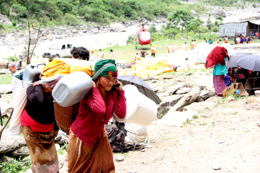 April 25, 2015 Nepal earthquake. In Nepal's mountainous Gorkha district, epicenter of the earthquake, World Vision delivered aid by helicopter. Some families walked more than four hours to reach the delivery spot to pick up tarpaulins, jerry cans, solar lamps, and hygiene supplies to carry back to their tent shelters.