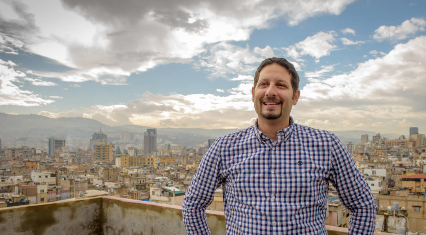 Director of Youth for Christ in Lebanon Maher El Hajj stands on a rooftop overlooking Beirut's Bourj Hammound community — an impoverished neighborhood that's home to Armenians, Palestinians, Kurds, Iraqis, Syrian refugees, and Lebanese.