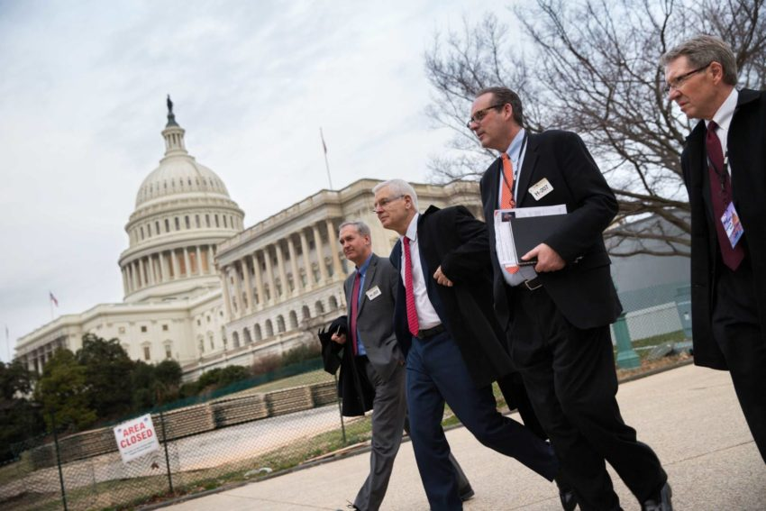 World Vision representatives walk for a meeting with a congressman in Washington, D.C.