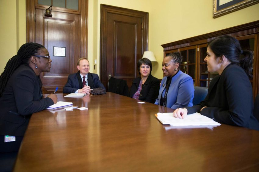 Greg Loewer, Lisa Cummins, Beylynda Gentry, and Christina Bradic meet with Senator Tim Kaine's Deputy State Director and Legislative Assistant Keren Charles Dongo on Capitol Hill during the World Vision Pastor and Influencer Advocacy Summit in Washington, D.C.