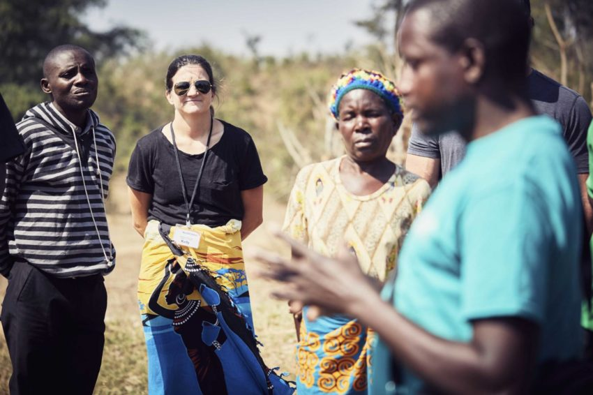 Olympic snowboarder Kelly Clark listens to community members in Zambia.