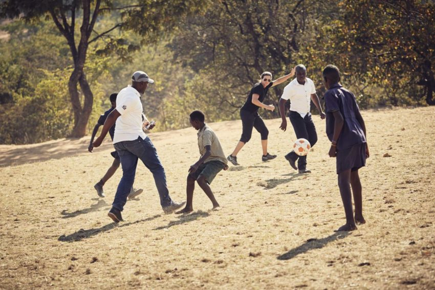 Olympic snowboarder Kelly Clark plays soccer in Zambia.