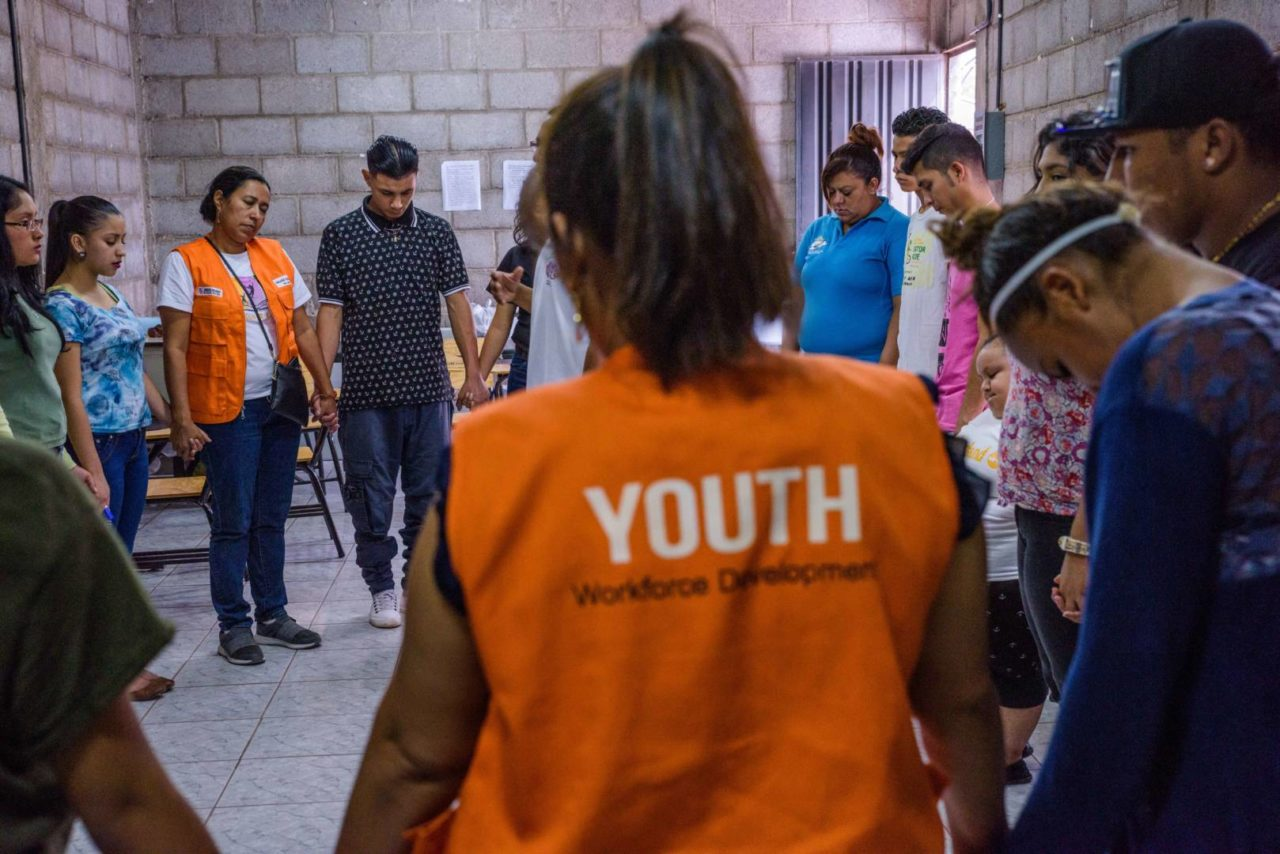 Youth and World Vision staff pray in Honduras.
