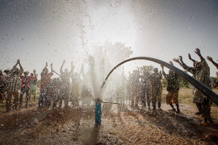 Djenidie residents in southern Mali dance to celebrate a World Vision well-drilling crew striking water June 5, 2017. This well marks World Vision's 1,500th borehole drilled in Mali since 2003. Still, only 16 percent of Malians in rural areas have access to hand-washing facilities with soap. Only about 64 percent of people in rural areas like Djenidie have access to an improved water source. World Vision is focused on bringing access to clean water to more than 800,000 Malians between 2010 and 2020.