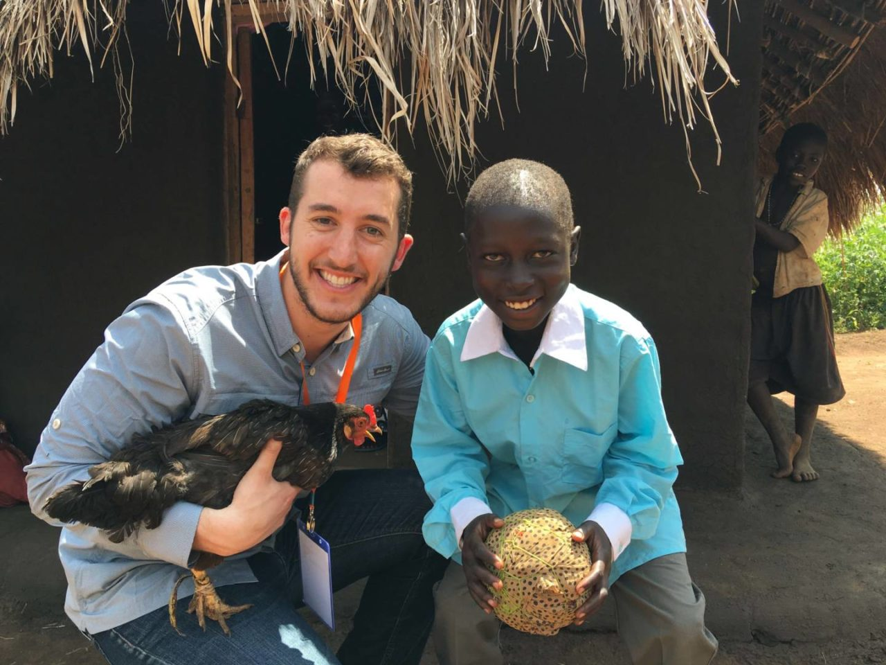 Reid Hutchinson poses with his sponsored child, Alfred, when he visited him in Uganda in 2016.