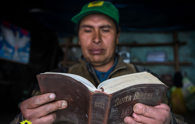Feliciano Rimachi Ramirez's hands tell his story and the story of his village, Carhuahuran, Peru. The Bible he holds was given to him by World Vision staff.