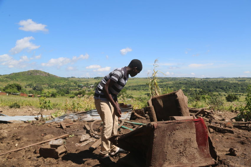Cyclone Idai affected more than 840,000 people in Malawi during March 2019. Geoffrey, 15, looks for items to salvage from his family's collapsed house. He and his five siblings were swept away in a mudslide when Cyclone Idai hit their home in Malawi. Their grandmother is recovering from injuries she suffered when she was buried in rubble.