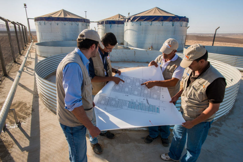 World Vision staff work to install water, sanitation and hygiene infrastructure before the first Syrian refugees arrive at Azraq Camp in Jordan.