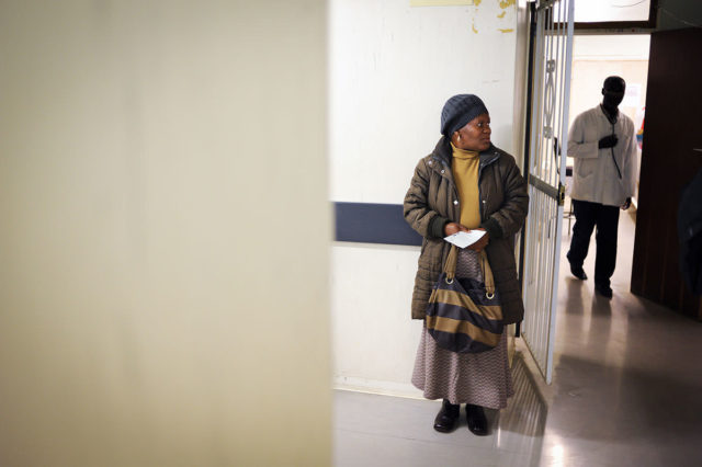 Emily Mphahlele waits at the hospital in South Africa for a doctor to review her anti-retroviral prescription.