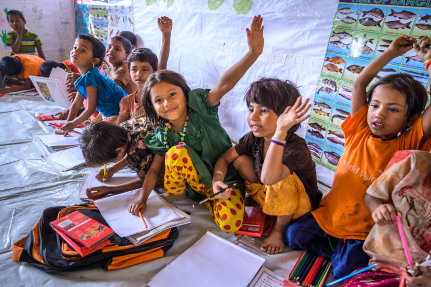 Refugee children learn alphabets inside a Child-Friendly Space.