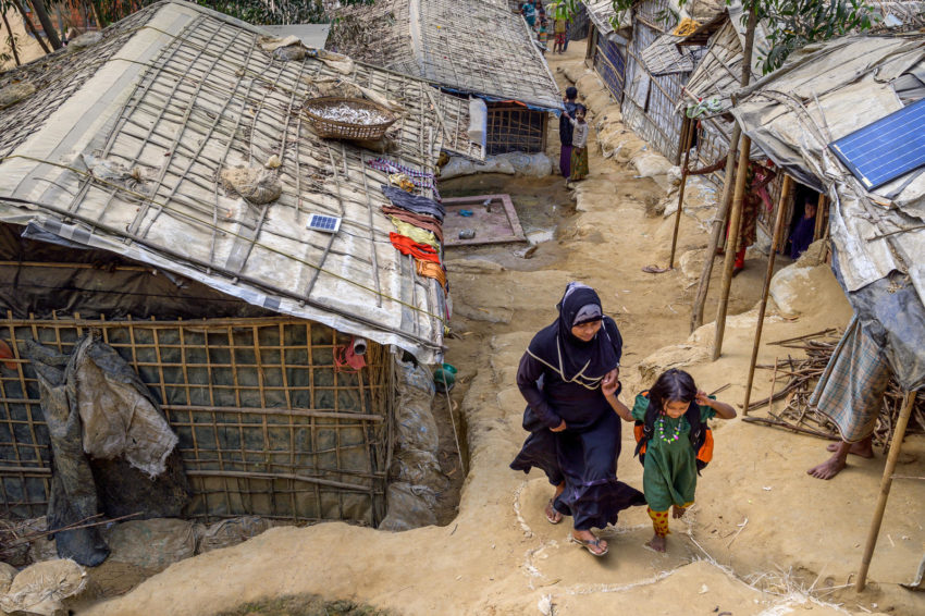 Jannatul, 5, and her mother, Salima, walk home from a World Vision Child-friendly Space in the refugee camp where they live in Bangladesh. Close to 1 million people live in the refugee camps in Cox's Bazar, Bangladesh. Most have fled their homeland since August 2017.