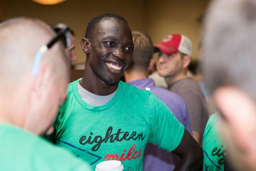 Lopez Lomong talks to others at a dinner the night before the 2016 Hood to Coast Relay.