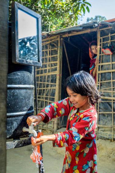 Girl washing her hands