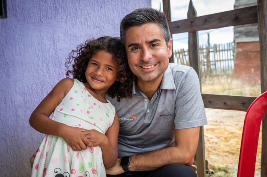 A man poses for a photo with a little girl