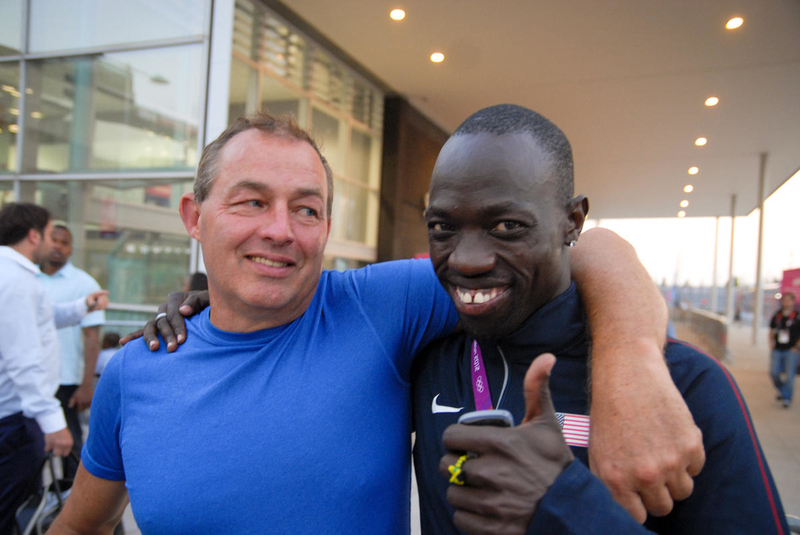 Lopez Lomong and his father, Robert Rogers, outside the Olympic Village in London at the 2012 summer Olympics. Lopez finished 10th in the 5000m race.